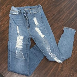 High waisted distressed denim jeans
